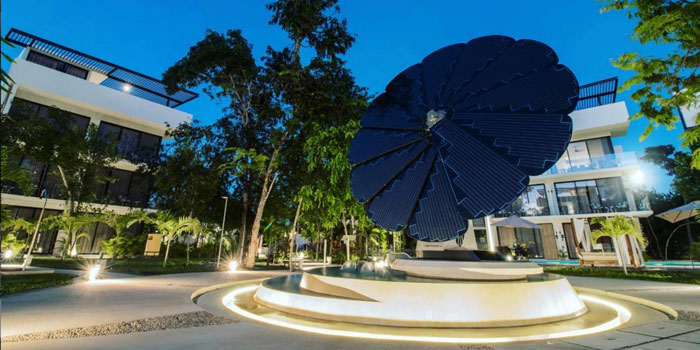 A SmartFlower Solar Panel Sits in the Middle of a Fountain Outside a Business Complex