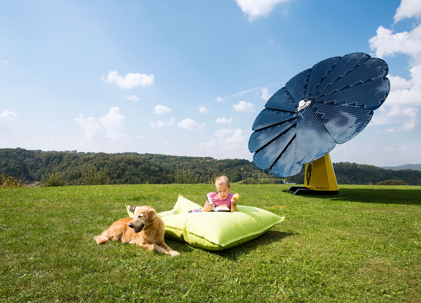 A Young Girl Reads a Book Outside With Her Dog Next to a SunFlower Solar Panel