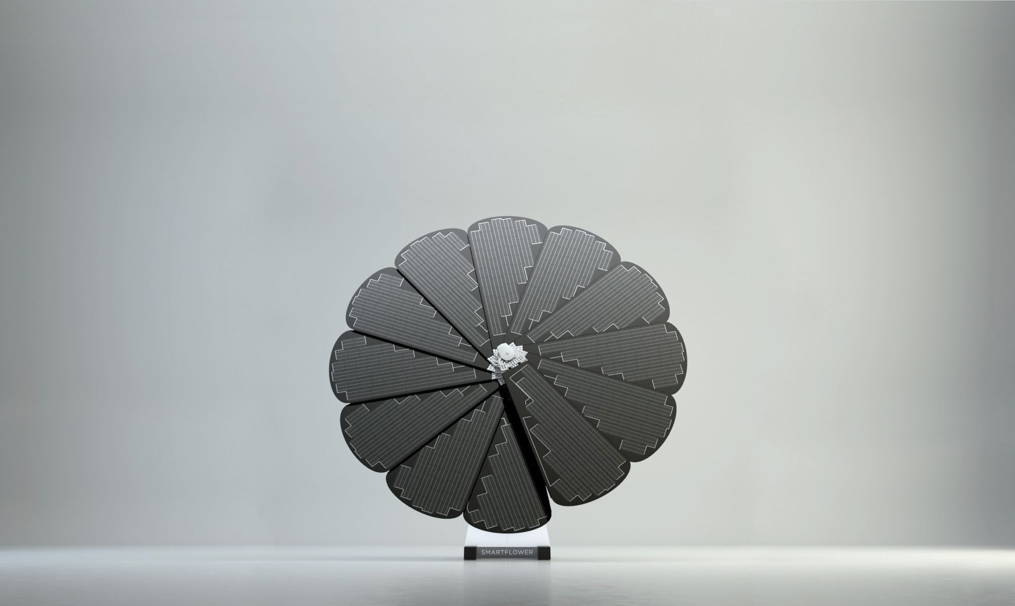 Single SmartFlower Stands Against a Grey Background in an Open Studio