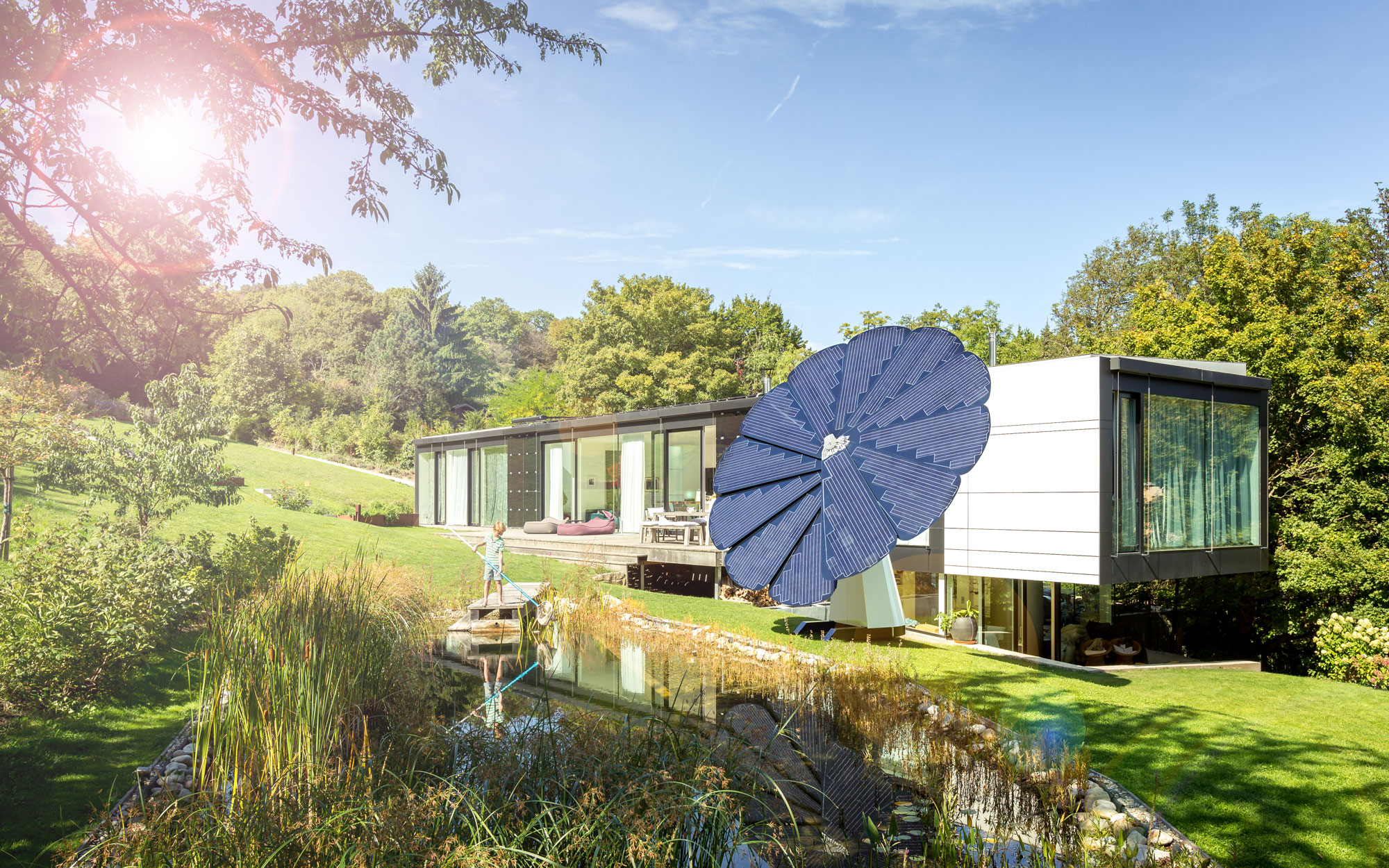 A SmartFlower Solar Panel Sits Outside a Modern Looking Home Surrounded by Trees