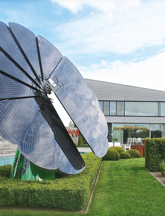 One SmartFlower Solar Panel Stands Outside a Family Home